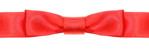 Symmetric red bow knot on wide silk ribbon Royalty Free Stock Images