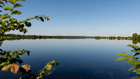 Symmetric reflections on calm lake Stock Images