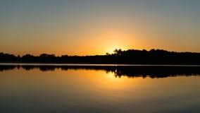 Symmetric reflections on calm lake Stock Photo
