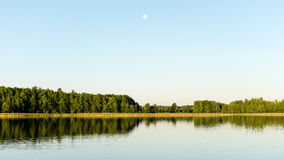 Symmetric reflections on calm lake Royalty Free Stock Photos