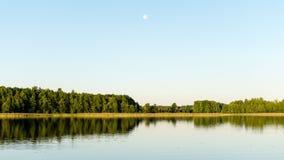 Symmetric reflections on calm lake Royalty Free Stock Photos