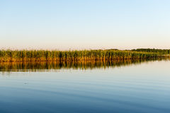 Symmetric reflections on calm lake Royalty Free Stock Photo