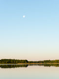 Symmetric reflections on calm lake Royalty Free Stock Photography