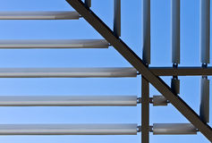 Symmetric roof made of steel. With lights and shadows Stock Photo