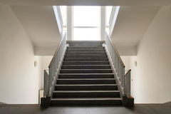 Symmetric stairs indoor. In public building. White and black Stock Photos