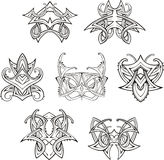 Symmetric tribal knot tattoos Stock Image