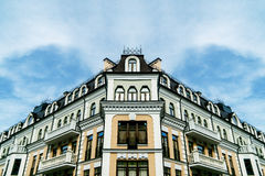 Symmetric view on the building. Symmetric building with sky on the background Stock Photo