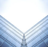 Symmetric wall of glass building Royalty Free Stock Image