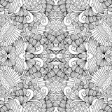 Symmetrical abstract seamless background. Full frame beautiful symmetrical seamless background filled with spiral  leafy shapes in black and white Royalty Free Stock Image