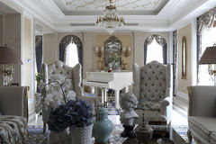 Symmetrical arches and sofa of the sitting room Stock Photo