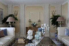 Symmetrical arrangement of family living room. Noble sofa on both sides respectively, thick books, sculpture and vase on the table Stock Images