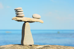 Symmetrical Balance. Well-balanced of pebbles on the top of stone Stock Photo