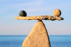 Symmetrical balance. Well-balanced of pebbles on the top of stone Royalty Free Stock Photos