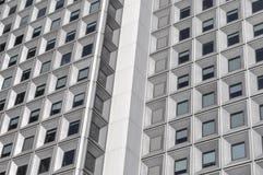 Symmetrical building facade, urban squares, modern mosaic. Photo presents the facade of a random building in shape of urban mosaic Stock Photos