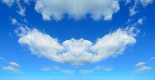 Symmetrical clouds Stock Images