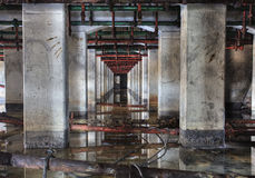Symmetrical Columns. In Abandoned Industrial Area Stock Images