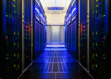 Symmetrical data center room with futuristic beams and rows of equipment Stock Image