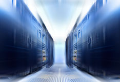 Symmetrical data center room with rows of equipment Blur and motion Royalty Free Stock Photo