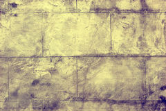Symmetrical details of a wall made with slabs of beton. Symmetrical details of an indoors wall made with slabs of beton Royalty Free Stock Photos