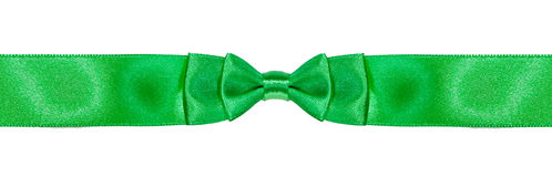 Symmetrical double bow-knot on narrow green ribbon Stock Image