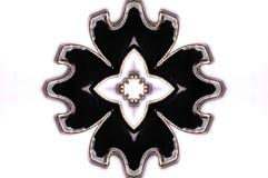 A symmetrical flower petal shaped pendant. A photo taken on a symmetrical flower petal shaped pendant against a white backdrop royalty free stock photo