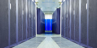 Symmetrical futuristic modern server room in the data center with Royalty Free Stock Images