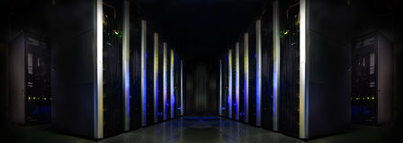 Symmetrical futuristic modern server room in the data center with Royalty Free Stock Photo