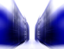 Symmetrical futuristic modern server room in data center with bright light Royalty Free Stock Images
