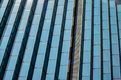 Symmetrical Geometric Glass Pattern on Skyscraper stock images