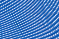 Symmetrical glowing lines blue with white stripes effect of movement part. Of the circle Stock Images