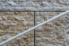 Detail of modern achitecture stone facade with handrail Royalty Free Stock Images