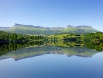 Symmetrical lake reflections in Marono at summer Stock Photos