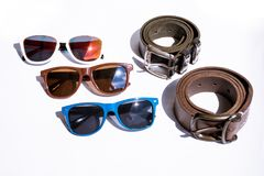 Symmetrical lined clothing accessories. Goggles and belts. Different types of sunglases Stock Photo