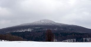 Symmetrical Mountain in Winter Landscape With White Cap Royalty Free Stock Photography