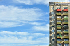 Symmetrical neighborhood worker building blue sky background Stock Image