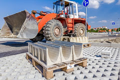 Symmetrical oblong precast rainwater canal placed on pallet is r. New concrete prefabricated gutter parts for drain water at building site. Canals to drainage Stock Photos