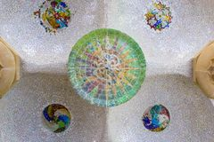Ceiling with mosaic sun roof tile at Guell Park, Barcelona, Spain. stock images
