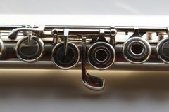 A symmetrical part of the silver transverse flute royalty free stock photography
