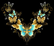 Symmetrical pattern of golden butterflies Stock Photo