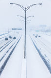 Symmetrical Photo of the Highway during a Snowstorm Stock Photo