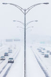 Symmetrical Photo of the Highway during a Snowstorm Stock Photos