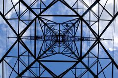 Symmetrical powerlines pylon Royalty Free Stock Photography