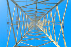 Symmetrical Pylon upwards against blue winter sky Royalty Free Stock Image