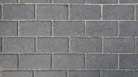 Rectangular gray cobblestones of the pavement. Top view royalty free stock photos