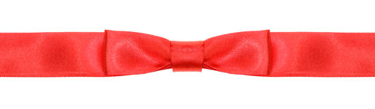 Symmetrical red bow knot on wide silk ribbon Stock Photos