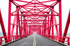 Symmetrical red steel structure construction of bridge and road in, Taiwan. Symmetrical red steel structure construction of bridge and road in Xiluo, Taiwan Stock Photo