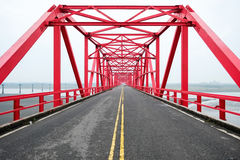 Symmetrical red steel structure construction of bridge and road in, Taiwan. Symmetrical red steel structure construction of bridge and road in Xiluo, Taiwan Stock Image