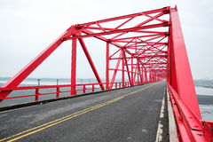 Symmetrical red steel structure construction of bridge and road in, Taiwan. Symmetrical red steel structure construction of bridge and road in Xiluo, Taiwan Royalty Free Stock Images
