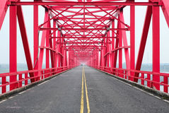 Symmetrical red steel structure construction of bridge and road in, Taiwan. Symmetrical red steel structure construction of bridge and road in Xiluo, Taiwan Stock Photos