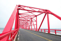 Symmetrical red steel structure construction of bridge and road in, Taiwan. Symmetrical red steel structure construction of bridge and road in Xiluo, Taiwan Stock Photography